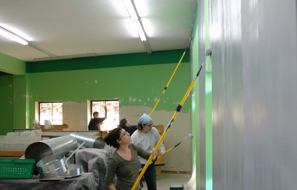 Members transforming our store with a coat of primer!